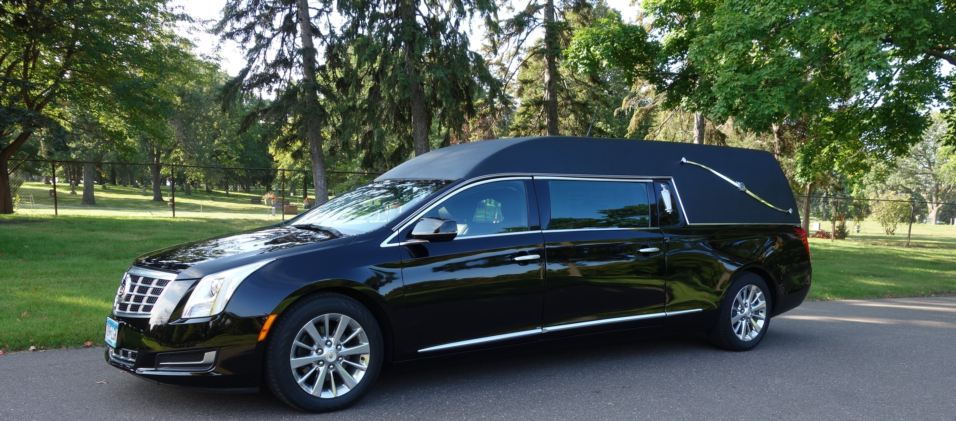 2014 Black Cadillac Federal side